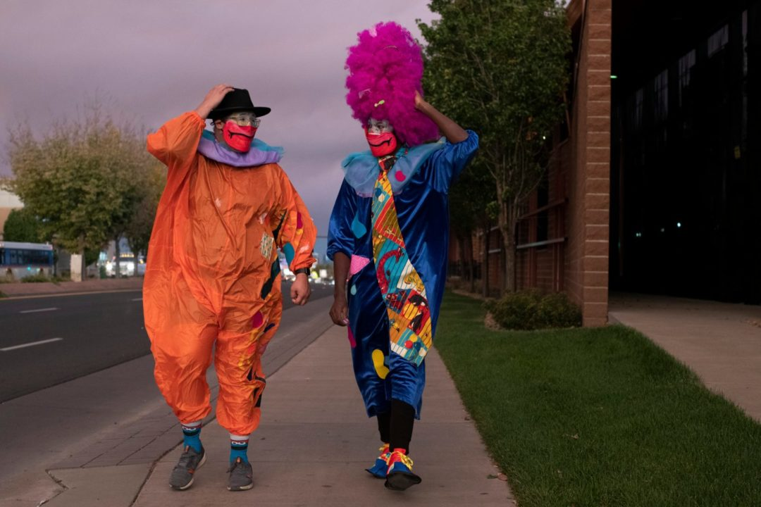 Image of two clowns walking along Colfax